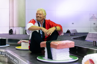 Richard Branson popped up at Brisbane Airport to formally announce the first ever Virgin flights from Brissy to Tokyo