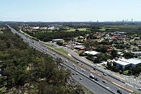 Merging of Brisbane and Gold Coast powers on, but 'don't blame developers' for growing pains