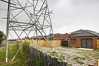 Neighbours' horror as home built with massive electrical tower in backyard
